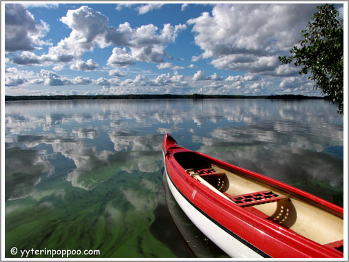 kayak on lake with clouds