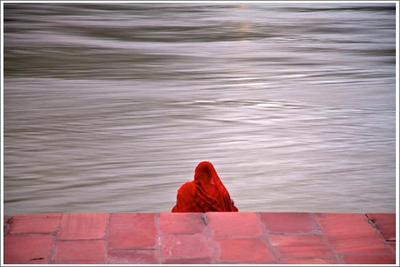 woman in red overloooking the river