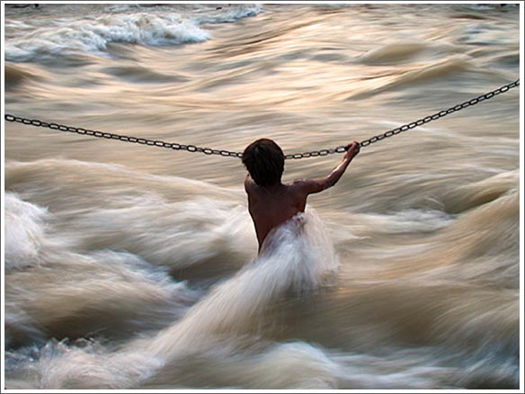 boy crossing a river
